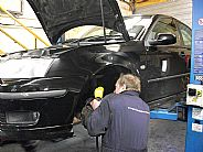 Frank Macdonald, Saab Mechanic for over 20 years, at work on a Saab